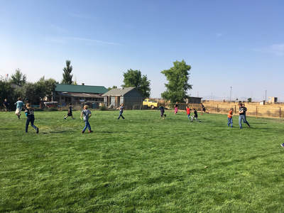 Students playing in field.